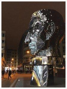 kafka-statue-at-night