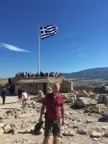 Brian atop Acropolis with Greek flag