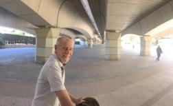 Frank on Bike under Bridge