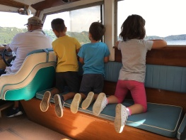 Kids on the ferry heading over to Isola di San Giulio